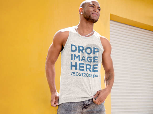 Tank Top Mockup of a Man Standing in Front of a Yellow Wall