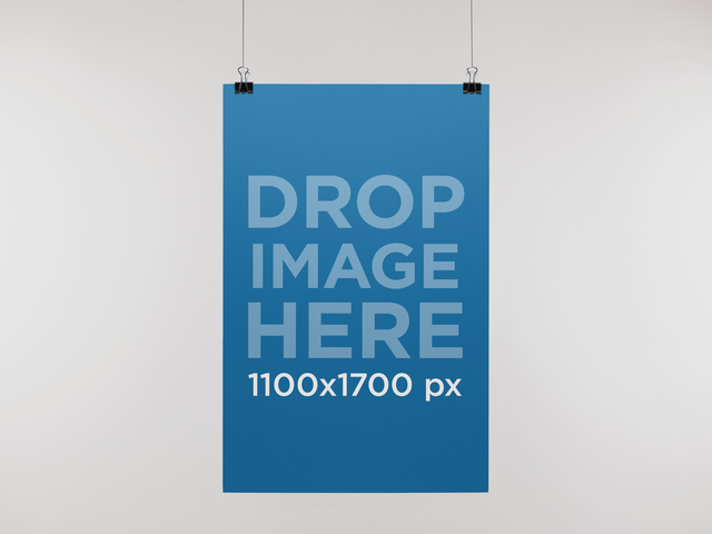 placeit paper poster mockup hanging from a wall