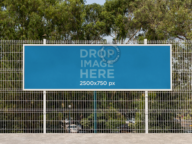 Horizontal Banner Mockup Hanging From a Fence at a School a10572