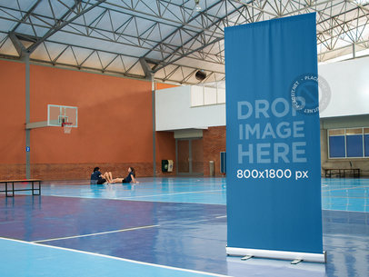 Vertical Banner Mockup at an Indoor Basketball Court a10591