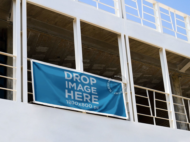 Horizontal Banner Mockup Hanging From a Balcony in a Stadium