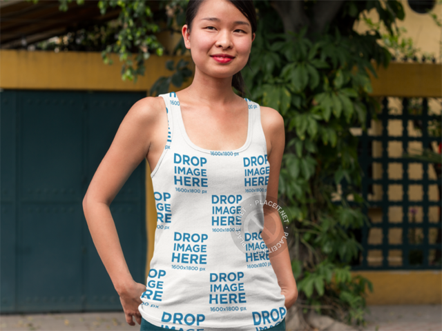 Tank Top Mockup of an Asian Woman Standing Outside her Home