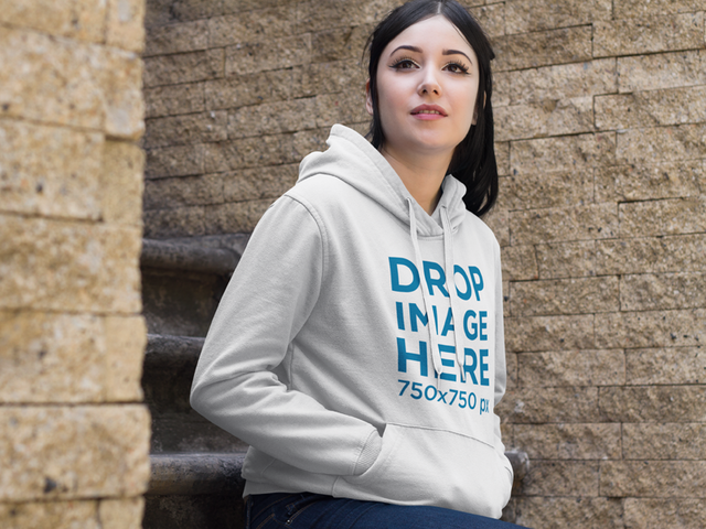 Hoodie Mockup of a Woman Sitting on a Stone Staircase a9414