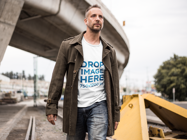 T-Shirt Mockup of a Man Walking Along a Railway a9371