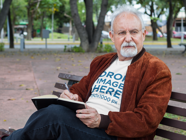 T-Shirt Mockup of an Elder Man at the Park Reading a10948