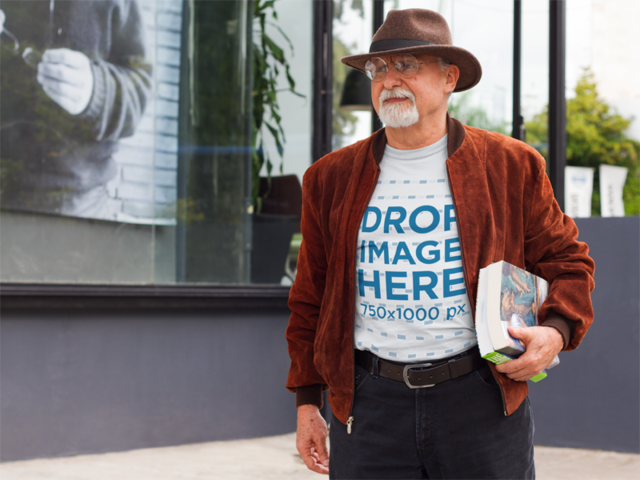 T-Shirt Mockup of a Man on the Street Carrying books a10941