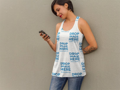 Tank Top Mockup of a Tattooed Woman Texting on her Phone a9240