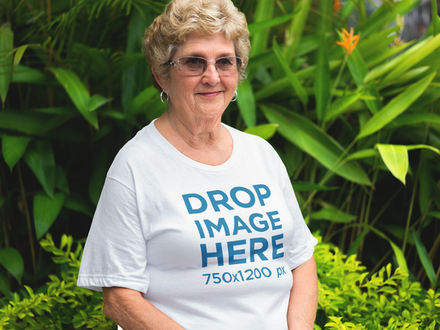 T-Shirt Mockup of an Elder Woman in her Front Yard a10939