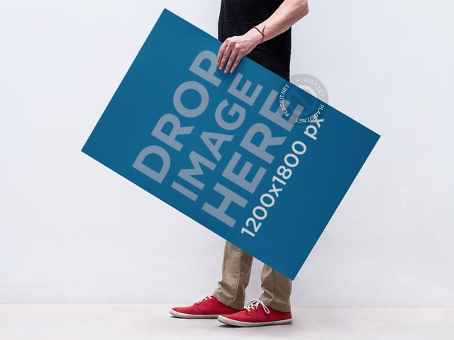 Poster Mockup of a Young Man Holding a Poster a10428