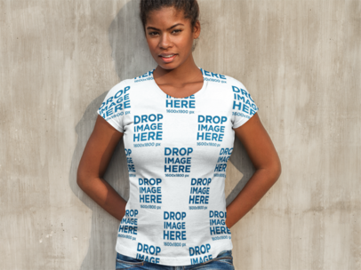 T-Shirt Mockup of a Woman Leaning Against a Concrete Wall a9646