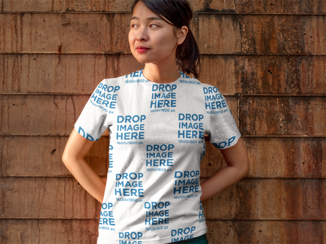 Asian Model Leaning on a Brick Wall T-Shirt Mockup a9443