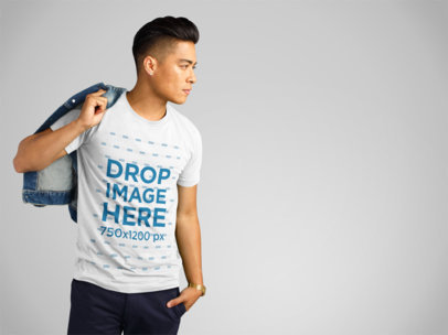 T-Shirt Mockup of an Asian Man Carrying a Denim Jacket a11152