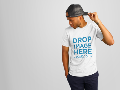 T-Shirt Mockup of a Young Black Man Wearing a Hat 11154