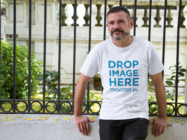 T-Shirt Mockup of a Hispanic Middle-Aged Man Outdoors a10851