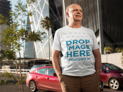 Mockup of an Elderly Man Wearing a T-Shirt Outdoors a11126
