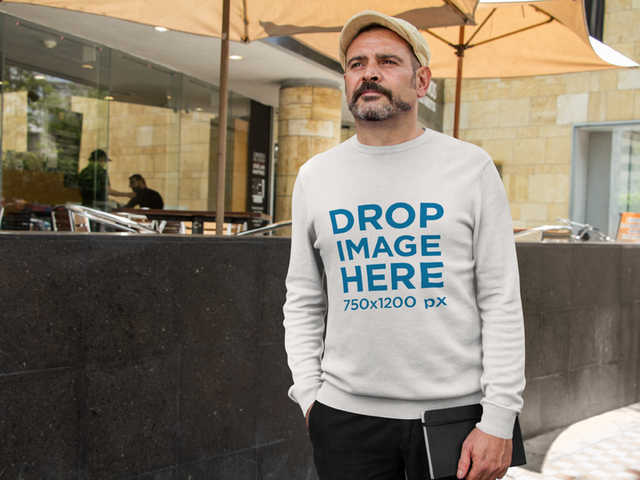 Hispanic Middle-Aged Man Wearing a Crewneck in an Urban Space a10854