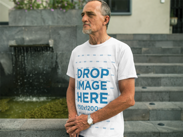 White Senior Man Wearing a T-Shirt in an Urban Space a10985