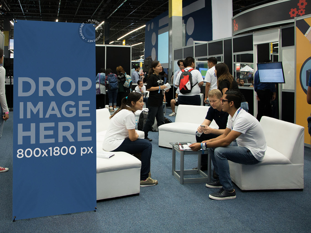 Mockup of a Roll-up Banner at an Expo a11245