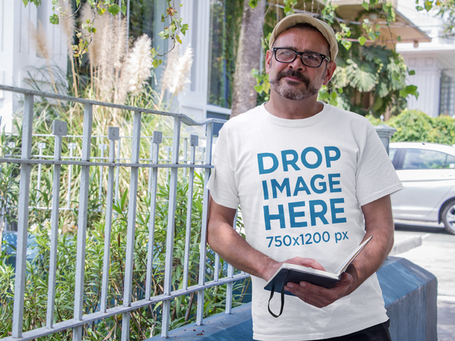 T-Shirt Mockup of a Middle-Aged Hipster Man Outdoors a10850