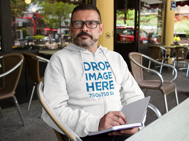 Middle Aged Man Wearing a Hoodie at a Cafe Mockup a10855