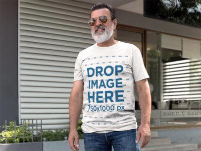 Outdoor T-Shirt Mockup of a Smiling Hispanic Senior a11312