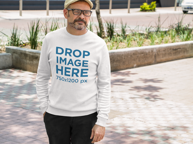 T-Shirt Mockup of an Elder Hispanic Man in an Outdoor Space a10853