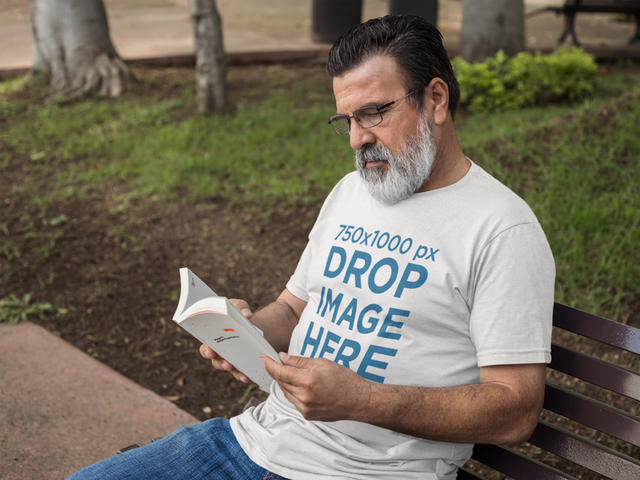 Hispanic Senior Wearing a T-Shirt While Reading Outdoors Mockup a11314
