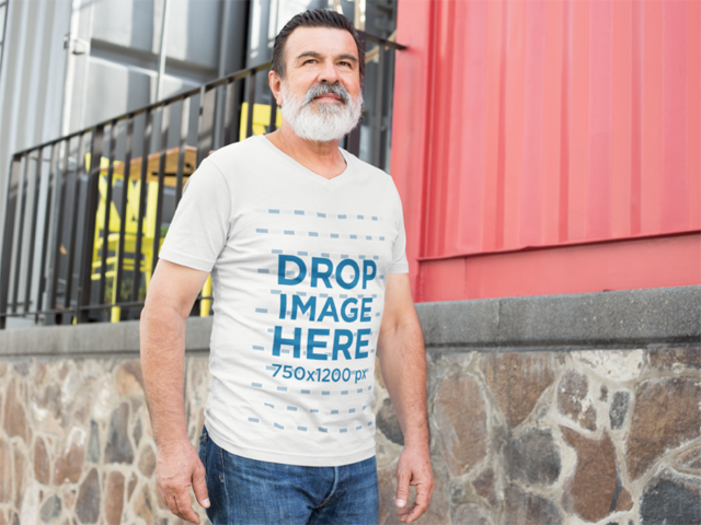 Mockup of an Elder Man Wearing a T-Shirt in an Urban Space a11302