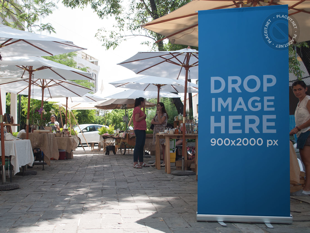 Roll-Up Banner Mockup at an Outdoor Bazar a11274