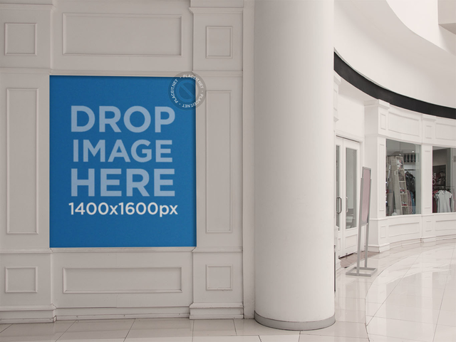 Placeit Poster Mockup Placed On A White Wall Inside A Mall