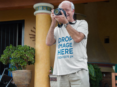 T-Shirt Mockup of a White Senior Taking a Photograph 11420
