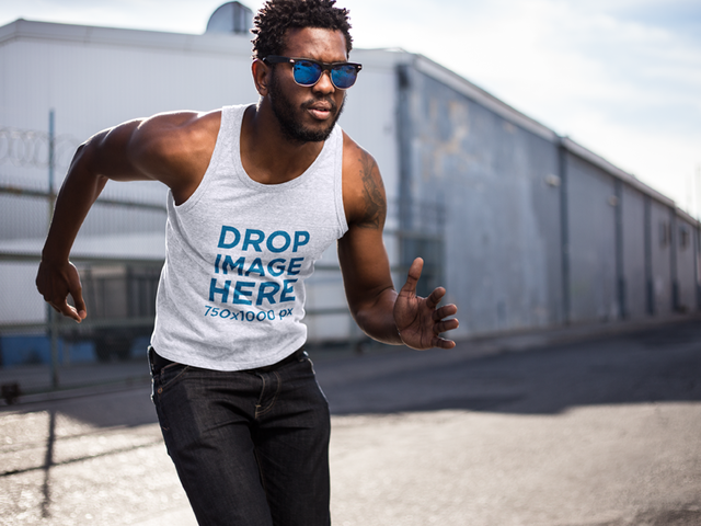 Young Black Man Wearing a Tank Top in a Dynamic Pose Mockup aa9529