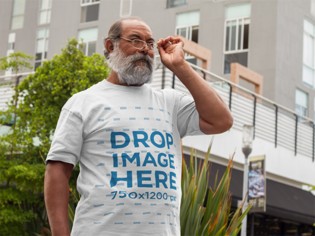 T-Shirt Mockup of a Hispanic Senior Wearing Glasses a11095