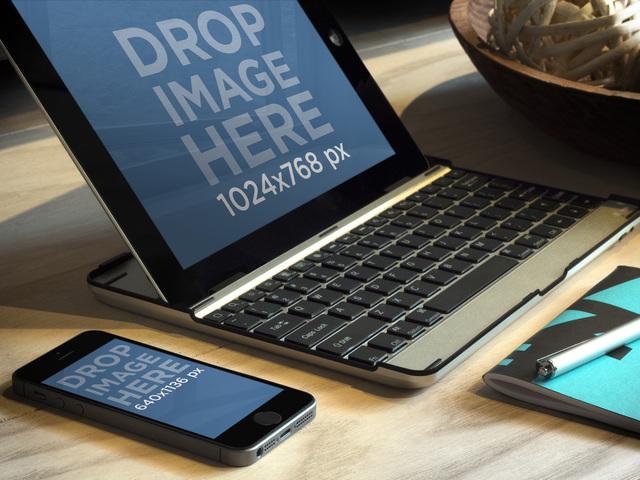iPad On Keyboard Deck Next To iPhone 5s Gray