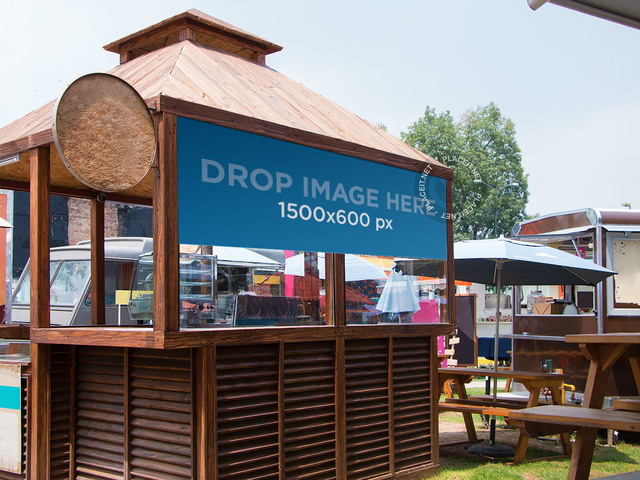 Horizontal Banner Mockup Over a Wooden Kiosk a11350