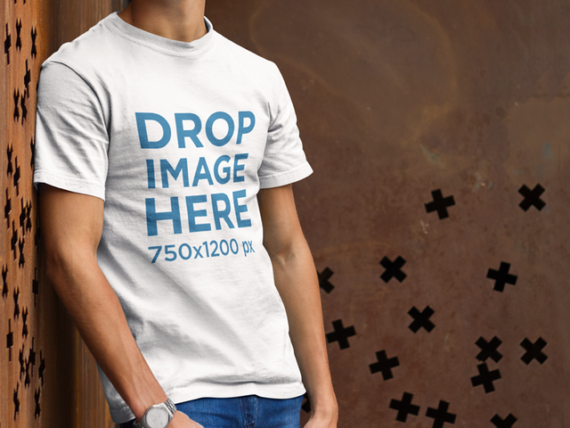 Simple T-Shirt Mockup of a Young Man Leaning Against a Wall a8643