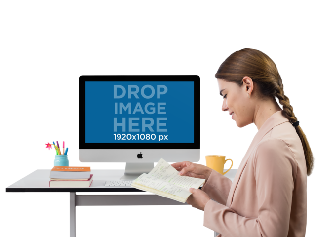 iMac Mockup Featuring a Woman With Her Planner a11505
