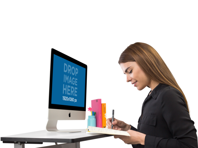 iMac Mockup of a Woman Writing in Her Agenda