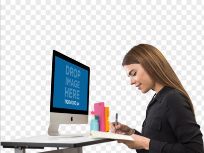 iMac Mockup of a Woman Writing in Her Agenda a11510