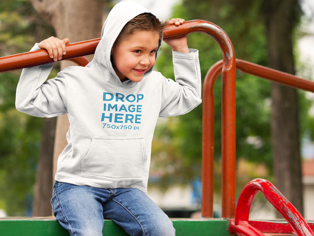 Little Boy Wearing a Hoodie at a Park Mockup 9110