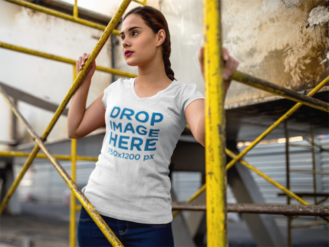 T-Shirt Mockup of a Young Woman in an Industrial Scenario 9090