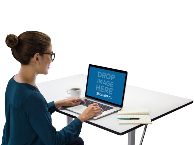 MacBook Mockup of a Female Executive at Work