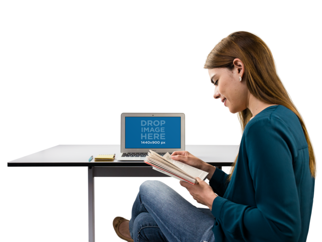 MacBook Mockup of a Woman Reading Her Notes