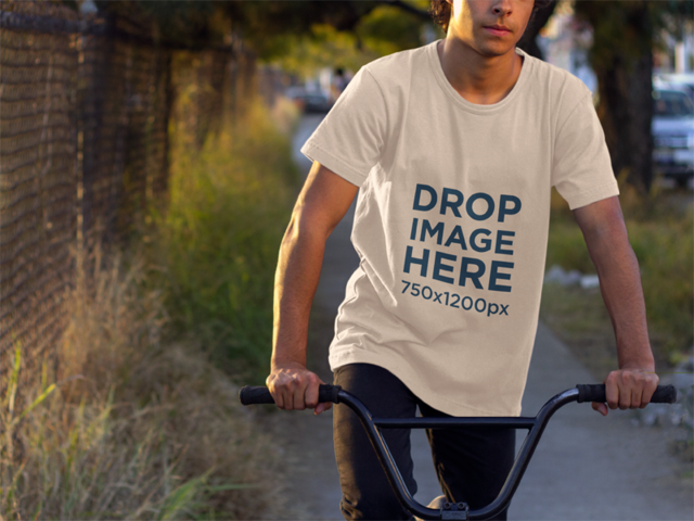 Tee Mockup of a Young Man Riding a Bike a8943