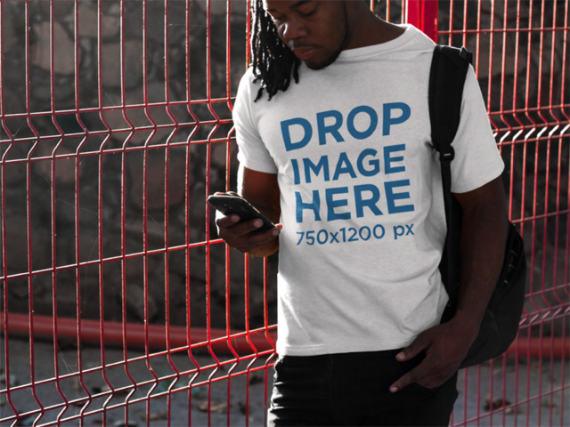 Tee Mockup of a Black Man With Dreadlocks Using His Smartphone b8773
