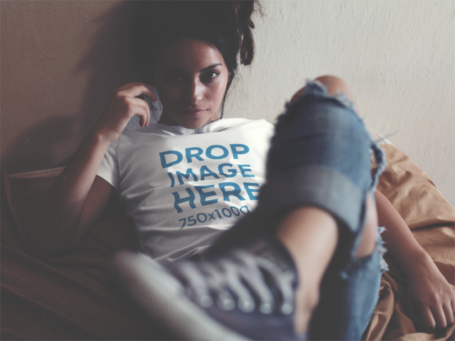 T-Shirt Mockup of an Alternative Young Woman Lying in Bed a11522