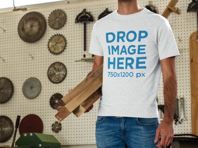 T-Shirt Mockup of a Young Man at a Workshop 8707