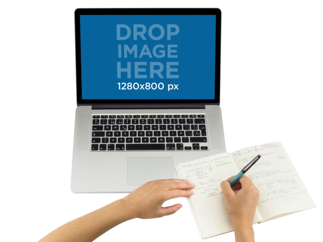 Top Shot Macbook PNG Mockup Featuring a Woman Writing in Her Notebook a11640