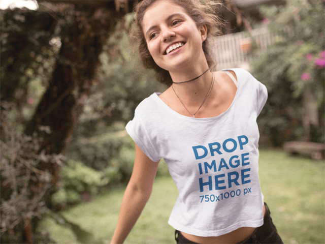 Happy Girl Jumping in Her Yard Tee Mockup a11581