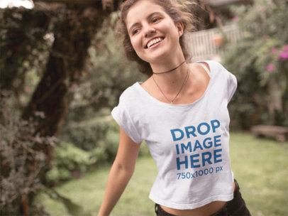 Happy Girl Jumping in Her Yard Tee Mockup a11581